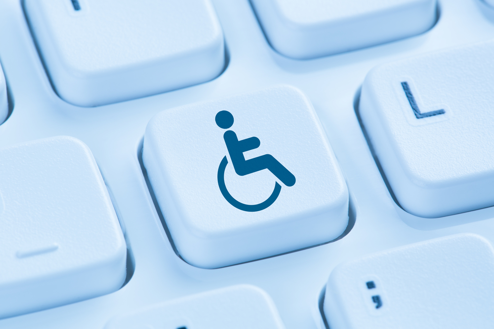 A keyboard key flashing a disability icon - an iconic representation of a person on a wheelchair.
