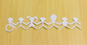Paper cut-outs of diverse people joining hands.